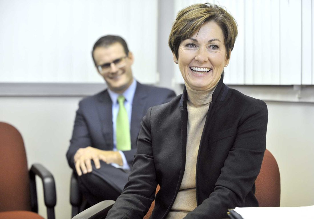 -Messenger photo by Hans Madsen  Iowa Governor Kim Reynolds smiles Thursday afternoon as she visits with The Messenger Editorial Board. Lt. Gov. Adam Gress, at left, listens.