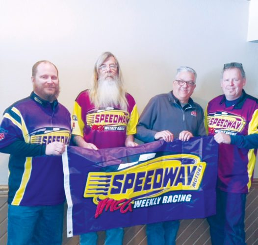 —Submitted photo  Sports Park Raceway co-promoters Jason Vansickel, Marty Pringle and Dave Doughty stand with IMCA's Jim Standard (third from left) after the announcement of Sports Park Raceway earning an IMCA sanction for next year.
