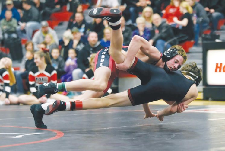 -Messenger photo by Britt KudlaCarson Taylor of Fort Dodge wrestles against Mason City Connor Wiemann on Thursday inside Dodgers gym