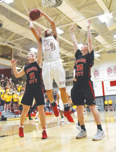-Messenger photo by Britt Kudla Jordan Jackson of Fort Dodge puts up a shot against Mason City on Friday