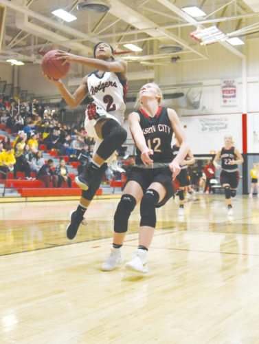 -Messenger photo by Britt Kudla Shareece Smith of Fort Dodge shoots around Mason City Anna Lensing on Friday