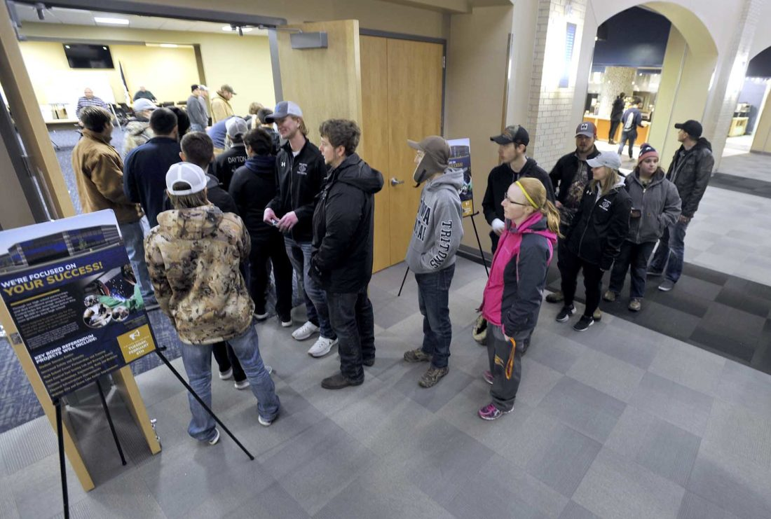 -Messenger photo by Hans Madsen  Iowa Central Community College students line up to vote in a satelite polling place set up in the Triton Cafe Tuesday.