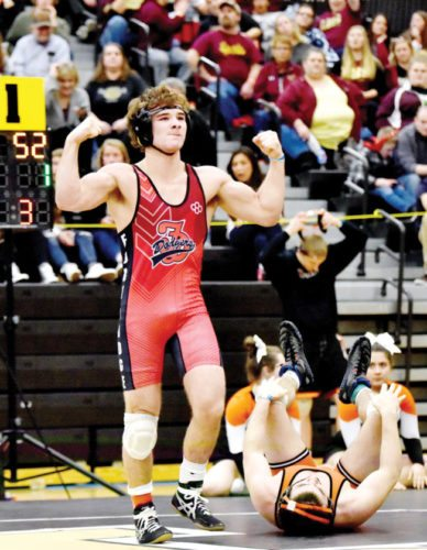 Messenger photo by Britt Kudla  Cayd Lara of Fort Dodge celebrates his CIML championship last year in Pleasant Hill. Lara is back as one of three Dodger defending champions.