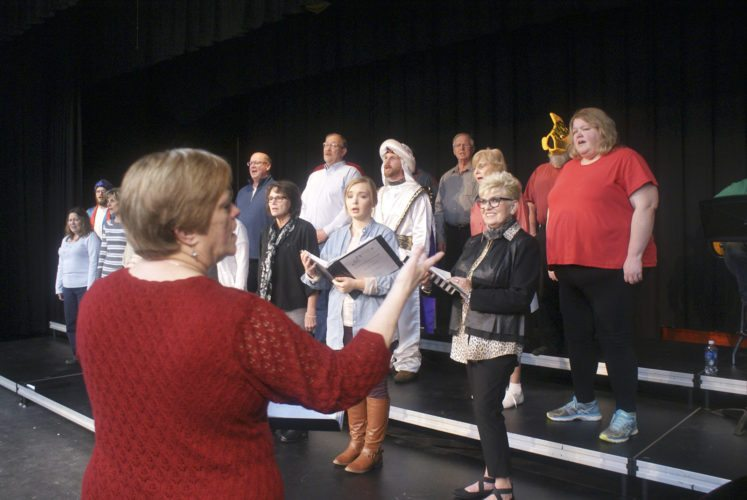 "-Messenger photo by Dawn Bliss   Lori Erkenbrack directs the Manson Meridian Singers at a recent rehearsal. The group's performance of ""Unite in Song"" is Saturday and Feb. 11 at the Manson Northwest Webster High School in Manson."