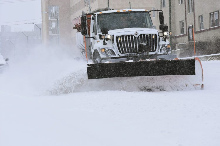 -Messenger photo by Chad Thompson  A city of Fort Dodge truck plows snow along South 8th Street Monday afternoon.
