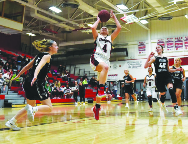 -Messenger photo by Britt KudlaBeth Murman of Fort Dodge drives towards the basket against Ankeny Centennial on Tuesday