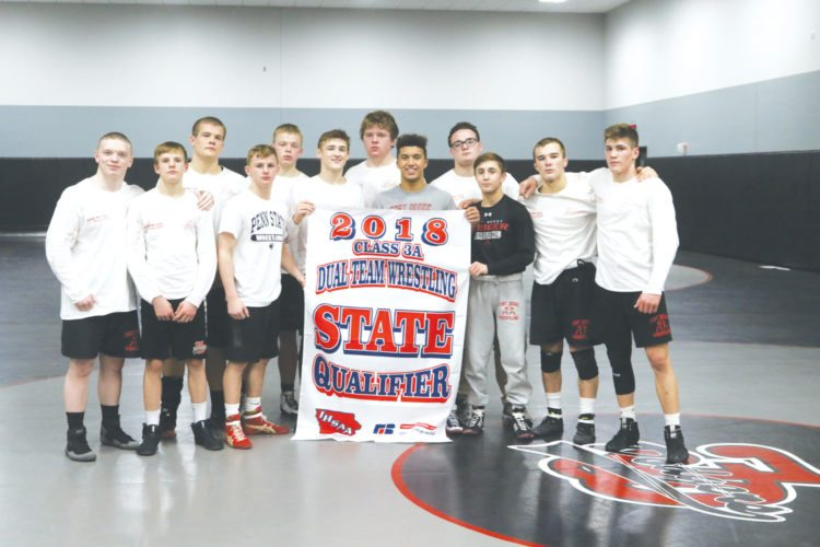 —Submitted photo The Fort Dodge wrestling team gathers after qualifying for the state dual tournament.