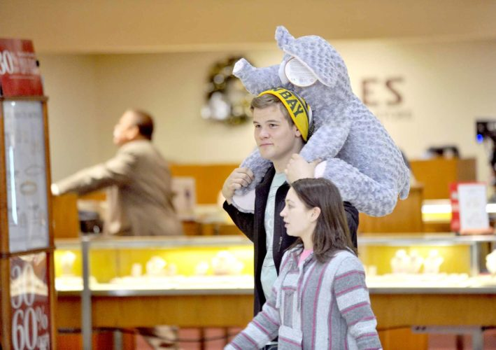 -Messenger file photo by Hans Madsen  Tim Elliott, of Fort Dodge, has the stuffed elephant duties down to a science at the Crossroads Mall. His friend Brittany Kalvig, 17, right, purchased the toy for her sister-in-law.