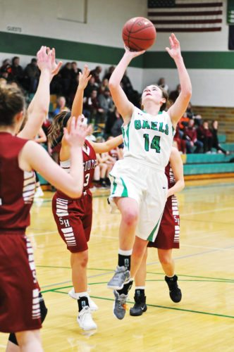 Photo by Tom Vogt  Jacque Oberg drives for St. Edmond against South Hamilton on Saturday night.