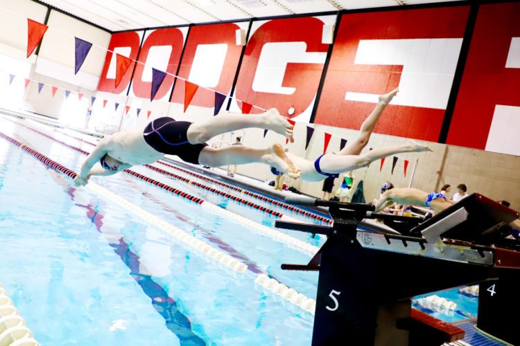Photo by Paul DeCoursey  Ian Hilbert jumps off the blocks for Iowa Central in the Dodger pool on Saturday.
