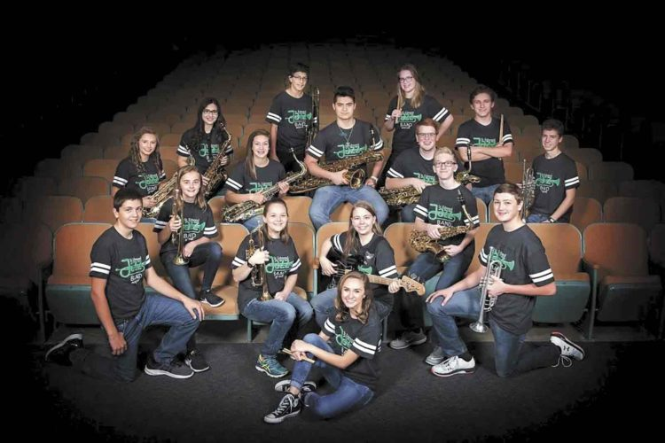 -Submitted photo  The St. Edmond Catholic School Jazz Band earned a Division 1 rating at the Iowa High School Music Association Jazz Festival recently. Pictured in back are Zoe Assadipour, Thornton Aljets, Ellie Wallace and Michael Peterson. In the second row are Morgan Border, Madigan Peimann, Rene Cazares, Nelson Cook and Aaron Simpson. In the front row are Brady O'Brien, Clare Conrad, Maggie Strickland, Brooklin Border, Emma Gruver, Jack Stackhouse and Korbin Brown