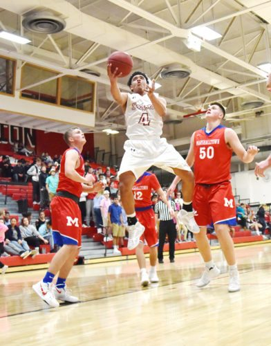 Messenger photo by Britt Kudla  Malcolm Clayton of Fort Dodge drives against Marshalltown in the Dodger gym earlier this season.