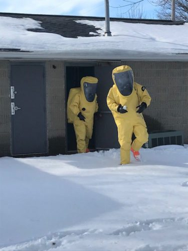-Submitted photo   Two members of the regional hazardous materials team walk out of the Duncombe water plant while working to control a chlorine leak there Wednesday afternoon. No evacuation was needed and no one was hurt during the incident.