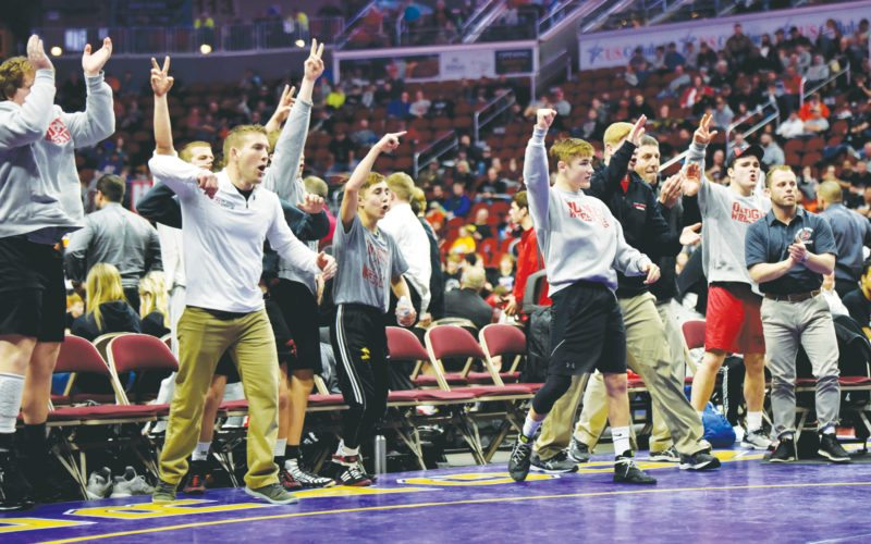 —Messenger photos by Britt Kudla  THE FORT DODGE BENCH (above) erupts after a Dodger victory on Wednesday at the state duals tournament. Senior Cayd Lara (below)reacts after clinching the state title for the Dodgers with a pin. For more photos, please visit CU.messengernews.net