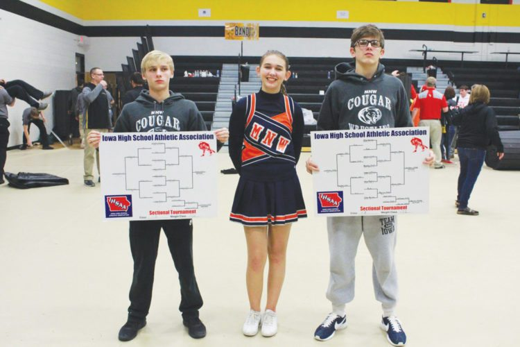 —Submitted photo  Siblings Alexis Hanson (center) and Koby Hanson (right) stand cousin Donavon Hanson after the two wrestlers qualified for state. Koby and Alexis are first cousins withDonavon.