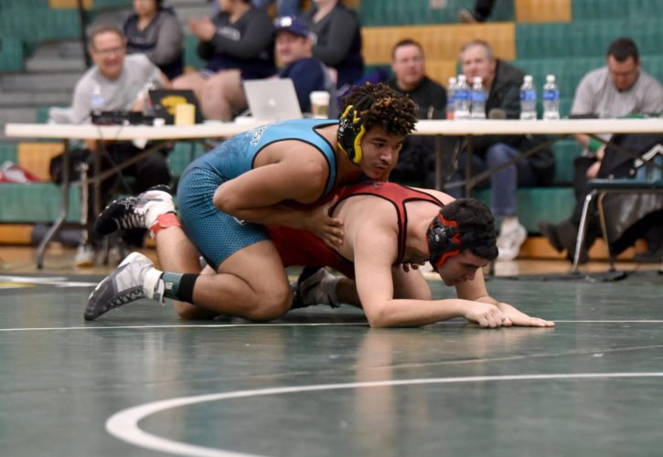 -Messenger photo by Britt Kudla Kyler Fisher of Southeast Valley wrestles against Roland-Story during St. Edmond Duals on Saturday
