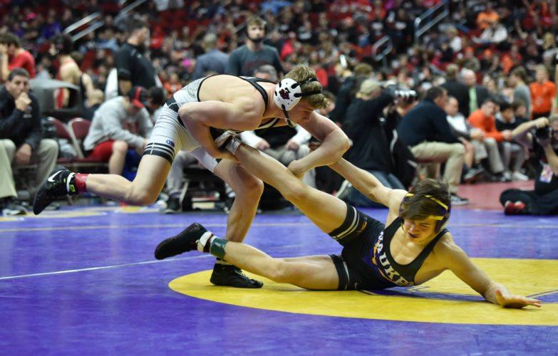-Messenger photo by Britt Kudla Brody Teske of Fort Dodge wrestles agaisnt Waukee Marcus Schneider during Class 3A Championship on Wednesday inside Wells Fargo Arena