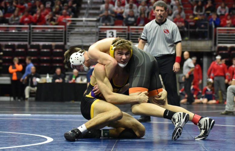 -Messenger photo by Britt Kudla Zane Williams of Webster City wrestles against Solon Seamus Poynton during Duals Consolations Championship on Wednesday at Wells Fargo Arena
