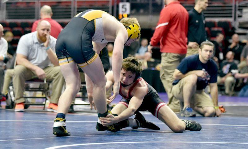 -Messenger photo by Britt KudlaDrew Bennett of Fort Dodge wrestles against Southeast Polk Ryan Strickland during class 3A state wrestling on Thursday