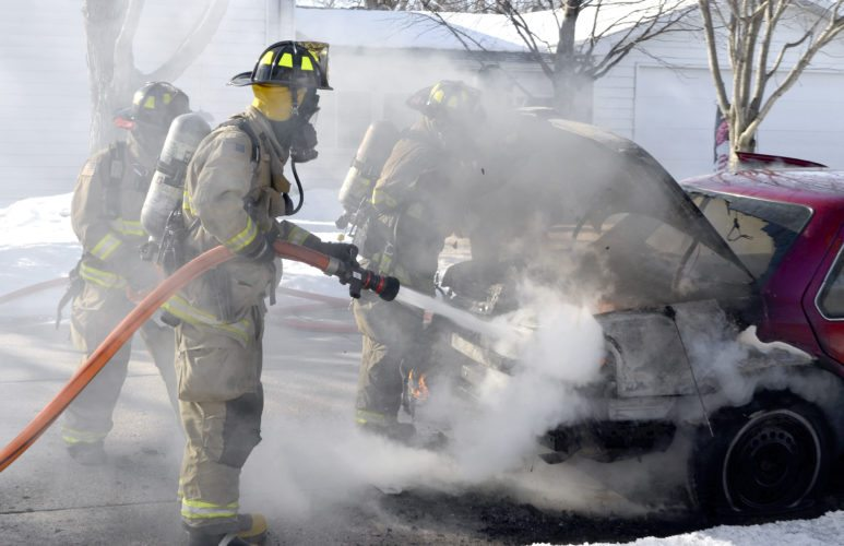 -Messenger photo by Peter Kaspari  Fort Dodge Firefighter Kyle Porter sprays water into the trunk of a burning car Friday morning. The car was at Fourth Avenue North and North 26th Place. Lt. Tom Ubben, of the Fort Dodge Fire Department, said there were some electrical issues with the fuel pump in the back of the car, which caused the material in the trunk of the car to catch fire. Ubben said the car is a total loss. The Fort Dodge Police Department was on scene to help with traffic control.