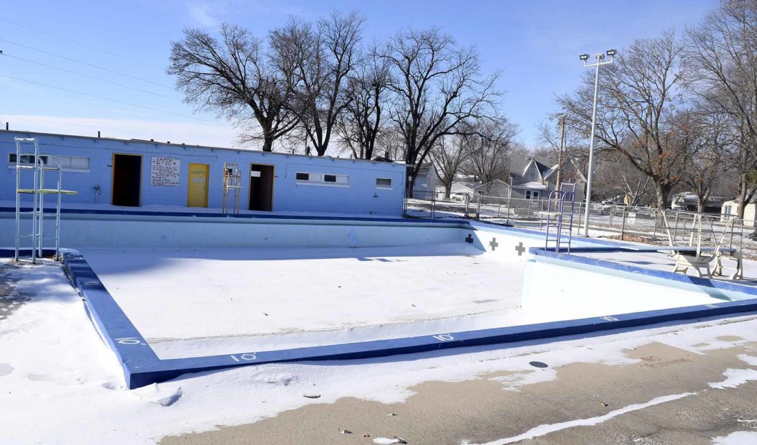 -Messenger photo by Peter Kaspari The Laurens city pool sits empty and filled with snow during the winter months. An ongoing project seeks to remodel the pool.