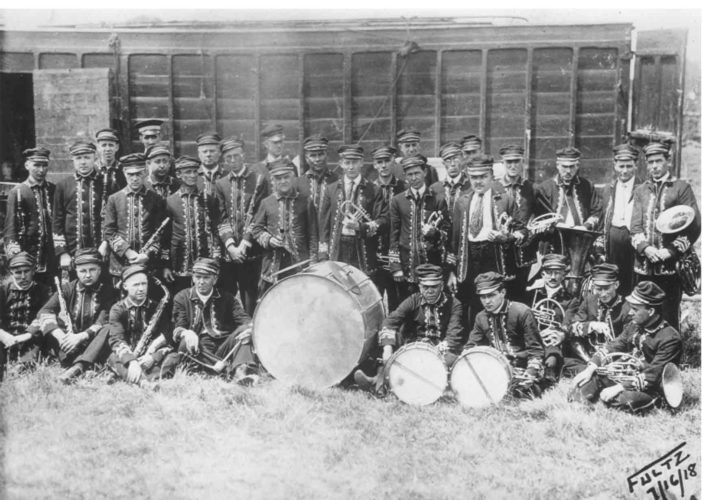 -Submitted photo  In this 1918 photo, the Barnum and Bailey Circus Band stands in front of a circus rail car. Director Karl L. King is seen wearing a different hat, standing tall in the back left.
