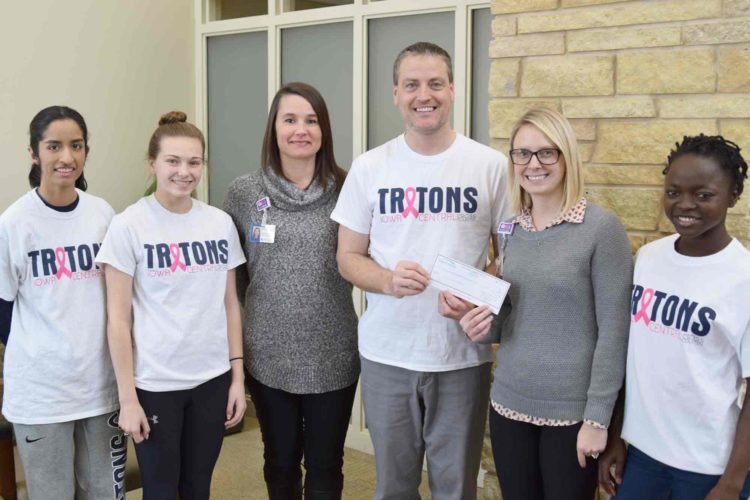 The ICCC cross country team recently presented the Trinity Cancer Center with $1,300. The team raised the money by selling T-shirts.  Pictured from left are Naomi Alvarez, a sophomore from Rosemount, Minnesota; Abby Gawthorp, a sophomore from St. Joseph, Illinois;  Alison Hanna, Trinity Foundation; Dee Brown, Iowa Central coach; Christen Sewell, Trinity Cancer Center; and Agnes Mansaray, a sophomore from Yeadon, Pennsylvania.