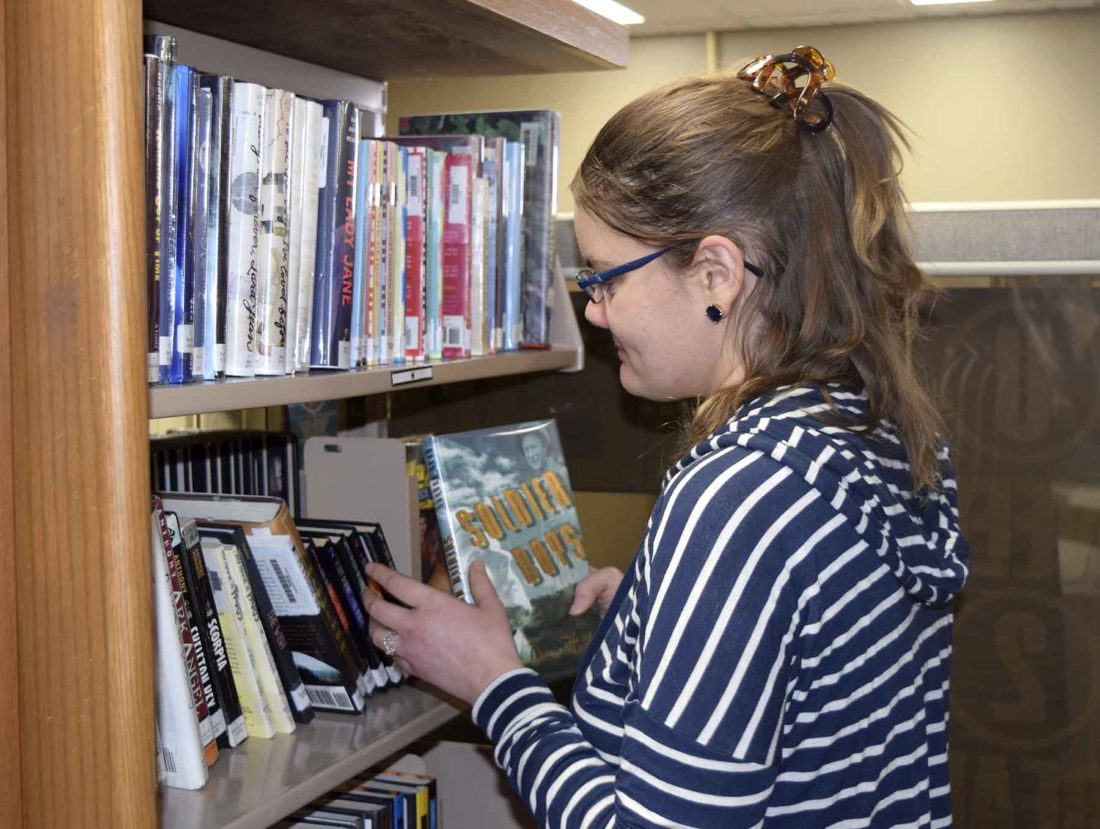 -Messenger photo by Peter Kaspari  Jeana Schott, of Pocahontas, browses the shelves at the Pocahontas Public Library recently. The library recently purchased a number of iPads that are available for the public to use.