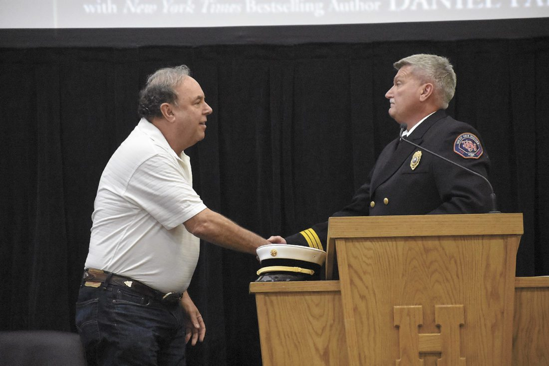 -Messenger photo by Chad Thompson  Richard Picciotto, former Fire Department of New York chief, left, shakes hands with Jerry Eslick, former Fort Dodge fire chief, during a Humboldt Volunteer Fire Department fundraiser Sunday afternoon.