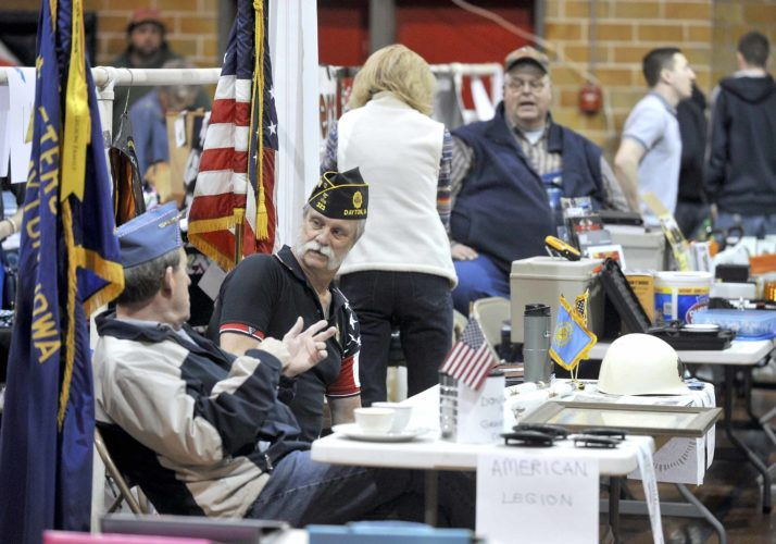 -Messenger photo by Hans Madsen  Doug Owenson, of Dayton, at left, along with Gary Zerwas, also of Dayton, chat in the American Legion Post 323 both at the Dayton Expo in the Dayton Community Center Saturday morning. The recently resurected Dayton Legion is starting a project to make sure all the veterans graves in Dayton and the McGuire Bend Cemeteries have the proper brass markers. Currently, about 50 graves are missing them.