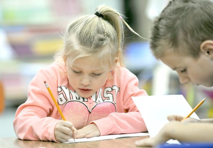 -Messenger photo by Hans Madsen  Millie Egli, who is adamently six and a half, works on making a card Friday afternoon during the Kindness Challenge Action Day at Manson Northwest Webster Elementary School in Barnum.