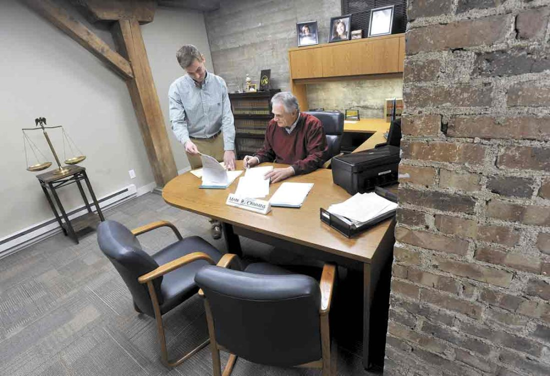 Crimmins U0026 Kehm Law Firm Partners Ryan Kehm, At Left, And Mark Crimmins,  Seated, Look Over Some Files In Crimminsu0027 New Basement Office.