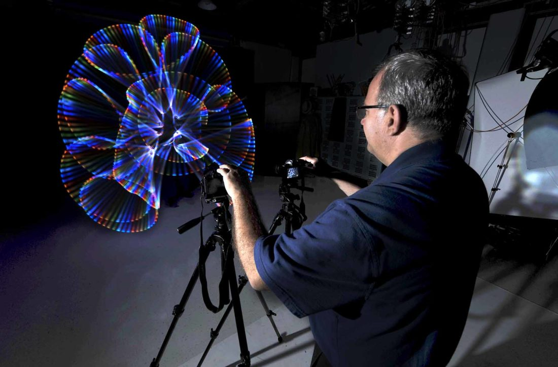 Photographer David Borer, Of Webster City, Mans The Camera As Fellow  Photographer Roger Feldhans, Of Pomeroy, Uses One Of His Many Light Tools  To Create A ...