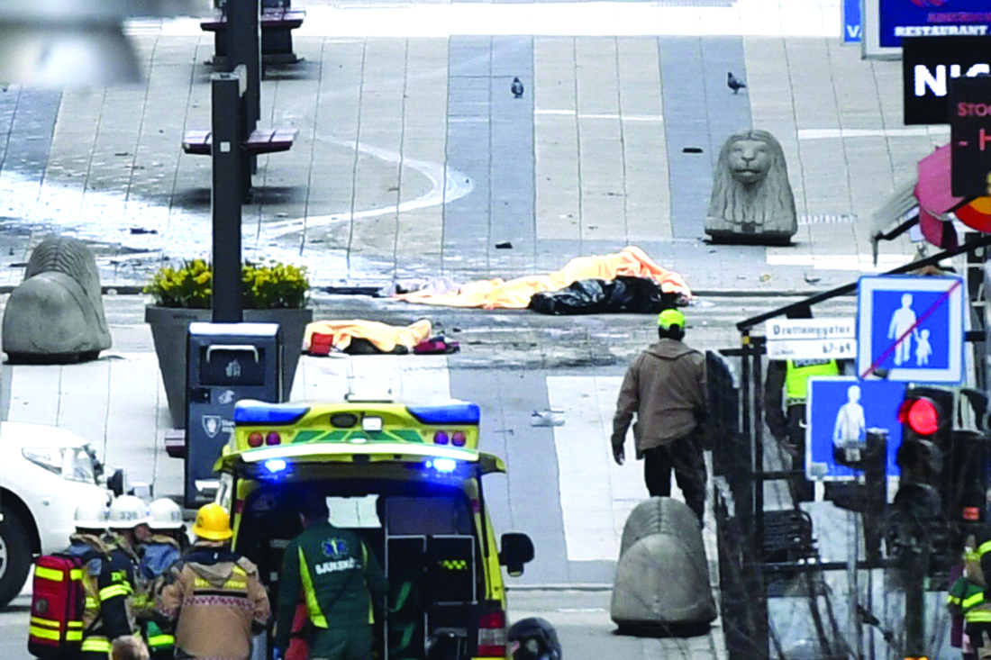 emergency services attend the scene after a truck was driven into a department store in stockholm sweden friday april 7 2017 the driver of a hijacked