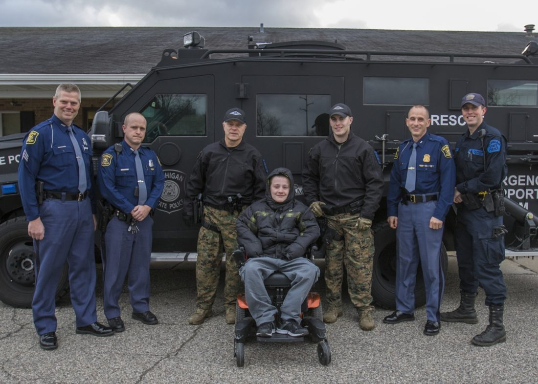 Michigan police grant wish of child with muscle disorder | News ...