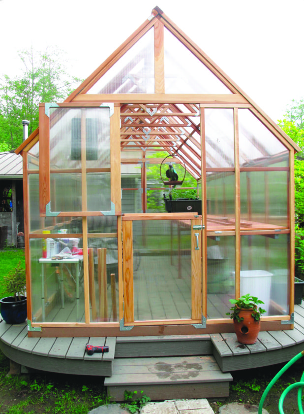 This May 11 2013 photo shows a Hobby Greenhouse in a Langley Wash. backyard. This greenhouse was built on a platform to prevent troublesome weed growth.  sc 1 st  The Mining Journal & Prevention is the best way to manage greenhouse weeds | News Sports ...