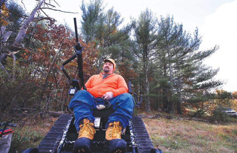 APPhoto  Paraplegic hunter Gary Dupuis, Ashburnham, Mass., waits in his all-terrain wheelchair, equipped with a shooting rack for his shotgun, while deer hunting in Devens, Mass.