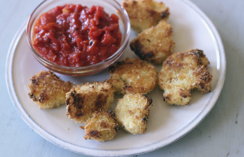 This shows breaded cauliflower cutlets with marinara sauce in Concord, N.H. This dish is from a recipe by Sara Moulton. (AP Photo/Matthew Mead)