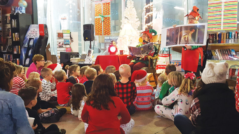 "Submitted Photo  Families listen to Danielle Sweeney as she reads ""The Polar Express"" Tuesday evening at Main Street Books."