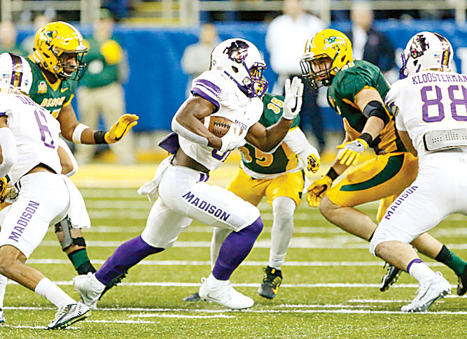 Forum News Service Khalid Abdullah of James Madison carries against North Dakota State during their NCAA FCS Semifinal football game Friday in Fargo.