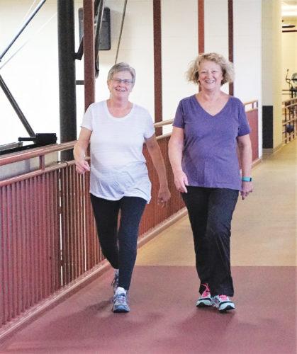 Jill Schramm/MDN Rosie Winczewski, left, and Sandy Drevecky walk on the track at the Minot Family YMCA Dec. 1.