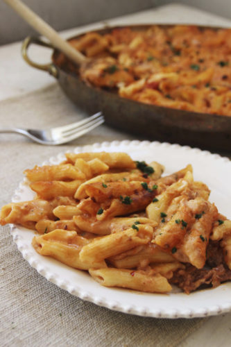 This photo shows baked penne pasta with proscuitto and fontina cheese in Concord, N.H. This dish is from a recipe by Sara Moulton. (AP Photo/Matthew Mead)