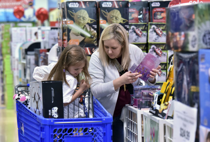 Stephanie Rowell and her daughter Sydney, 5, shop at Toys R Us - Town Center in Kennesaw, Ga. Holiday shopping procrastinators can breathe easy. Yes, most online shipping deadlines have passed. But many retailers are offering other ways to get gifts at the last minute, whether it's staying open through the wee hours of the night like Toys R Us, or offering Christmas Eve store pickup like Wal-Mart. (Hyosub Shin/Atlanta Journal-Constitution via AP, File)