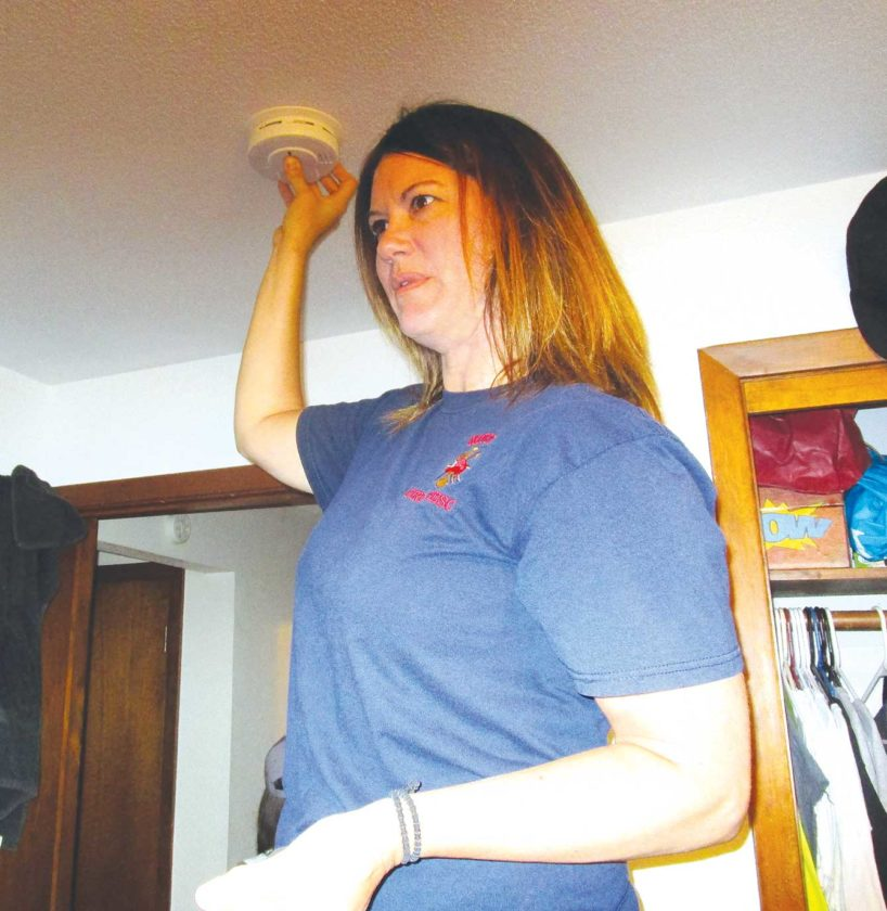 Allan Blanks/MDN Kelli Flermoen is the first woman to be named fire chief of the Minot Fire Department. During the summer, Flermoen collaborated with the American Red Cross to inspect and install smoke detectors in the homes of Minot residents.