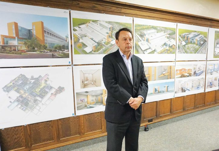 File photo  R. Wayne Estopinal, president of TEG Architects, stands in front of schematics of the new medical park as he discusses the progress with the project in November.
