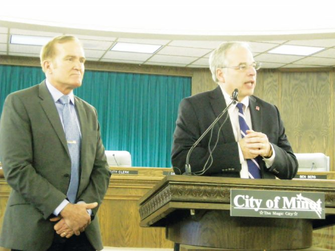 Jill Schramm/MDN  Mayor Chuck Barney, right speaks at a news conference with now former city manager Lee Staab, left, last January to discuss Minot's award of $74.3 million in the National Disaster Resilience Competition.