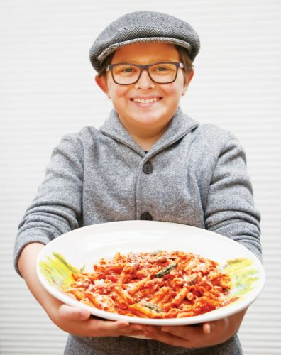 Forum News Service Giovanni Nasello, 12, makes his own Italian sausage with ground pork, toasted fennel seeds, crushed red pepper, minced garlic, salt and pepper.