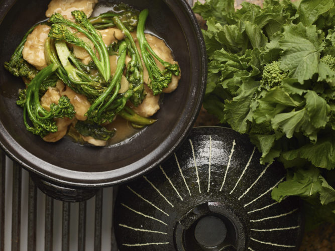 This Jan. 2, 2017 photo provided by The Culinary Institute of America shows Chinese take-out chicken and Broccoli Rbe in Hyde Park, N.Y. This dish is from a recipe by the CIA. (Phil Mansfield/The Culinary Institute of America via AP)