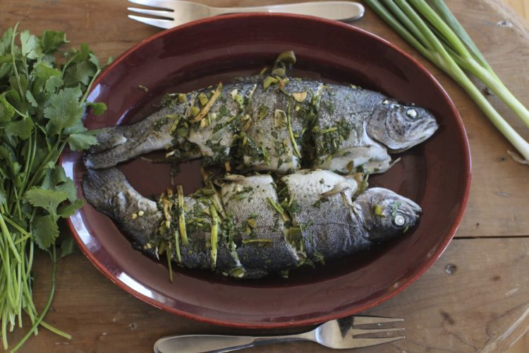 This file photo shows baked whole fish in Concord, N.H. This dish is from a recipe by Sara Moulton. (AP Photo/Matthew Mead, File)