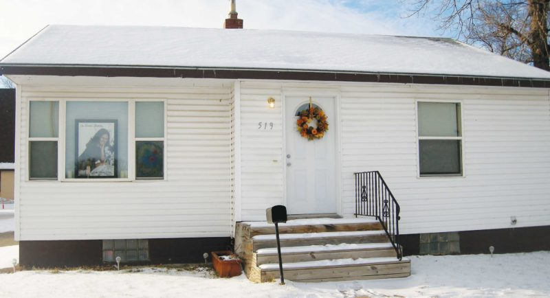 Andrea Johnson/MDN This was the home where Richie Wilder Jr. murdered his ex-wife Angila Wilder in November 2015. A memorial picture of Angila Wilder is shown in the front window of her home in northwest Minot in late December 2015.